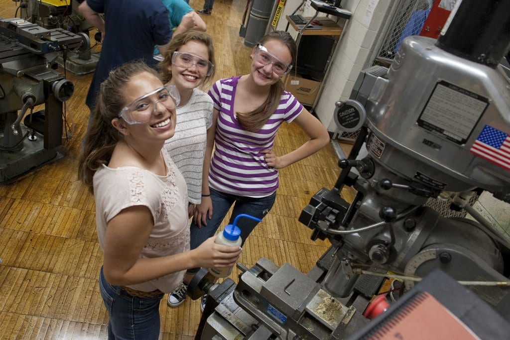 High school students participating in a program sponsored by the Technological Education Center for Deaf and Hard-of-Hearing Students (DeafTEC) at the Rochester Institute of Technology in Rochester, New York, learn about careers in manufacturing. DeafTEC is an Advanced Technological Education center.
