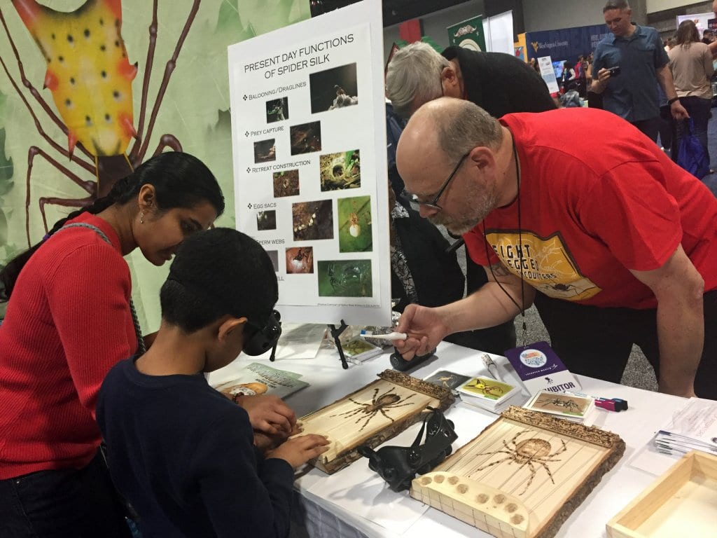 """Exhibitor at the """"Eight-legged Encounters"""" exhibit at the 2016 USA Science & Engineering Festival, which blended art and science to inspire scientific discovery and increase public understanding of the diversity and evolution of spiders and their relatives."""